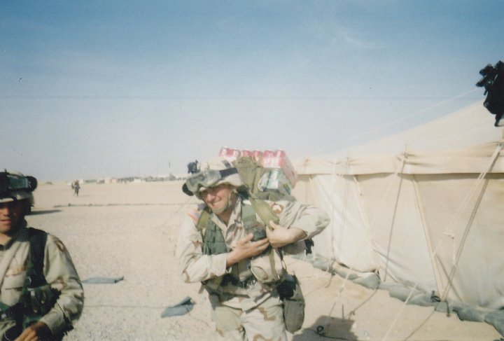 At a camp in Kuwait, carrying sodas to boost morale with the platoon!